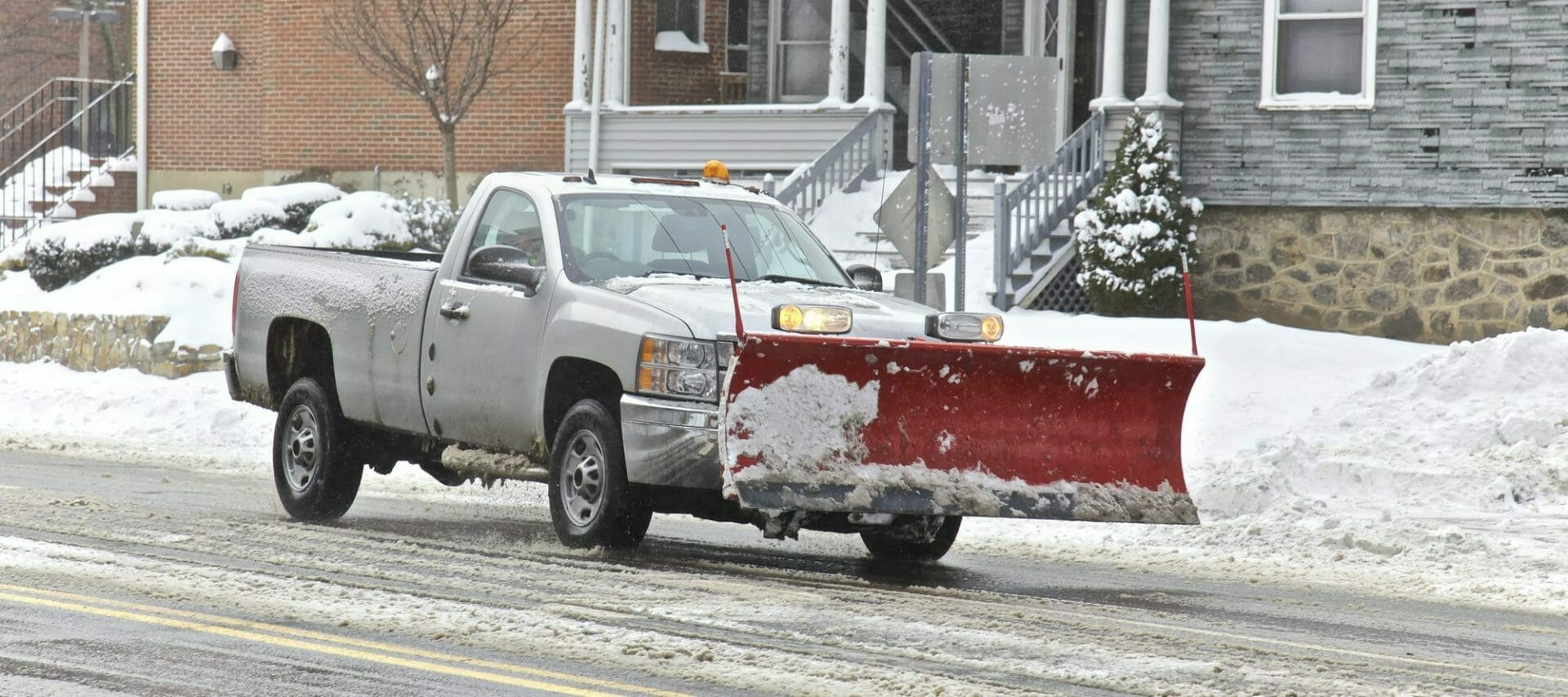 Truck with plow, Cleaning an icy road